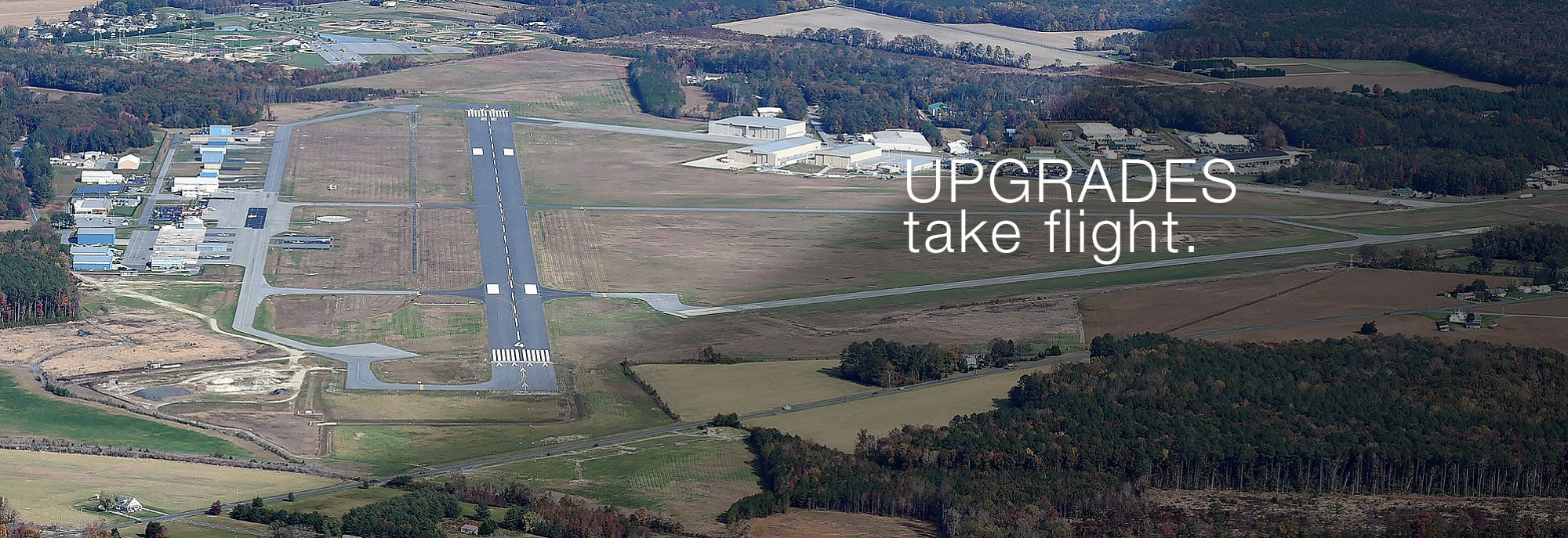 aerial view of sussex airport promoting upgrades take flight
